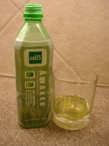 ALO Drink Awaken in the glass with bottle