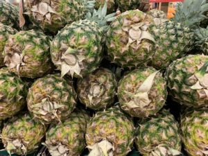 Fresh cut pineapples stacked on top of each other